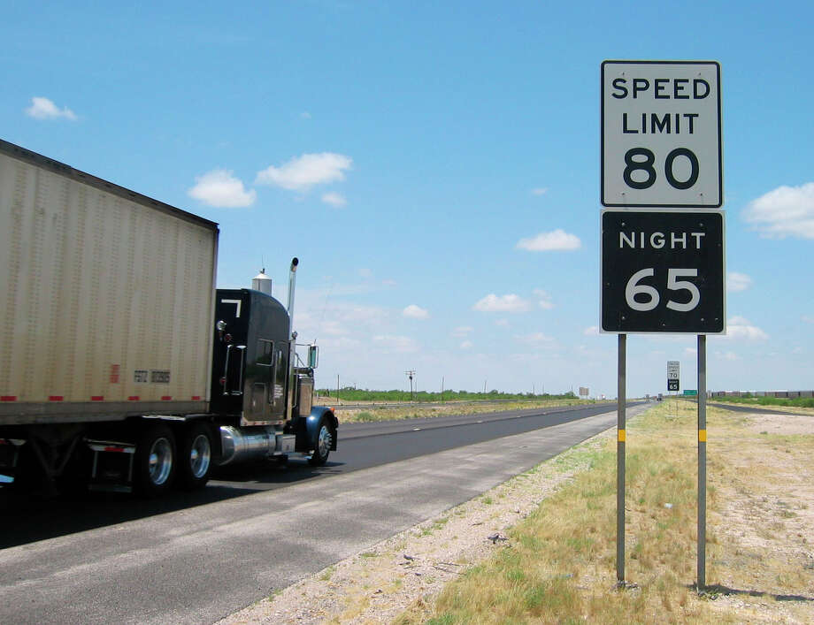 A truck barrels past a newly posted 80 mph speed limit sign just west of Monahans in West Texas, Wednesday, May 31, 2006. Cars on two stretches of rural Texas highways can now legally travel 80 mph, (130kph) the highest speed limit in the country. Truck speed limits remained at 70 mph. (AP Photo/Betsy Blaney) Photo: BETSY BLANEY / AP