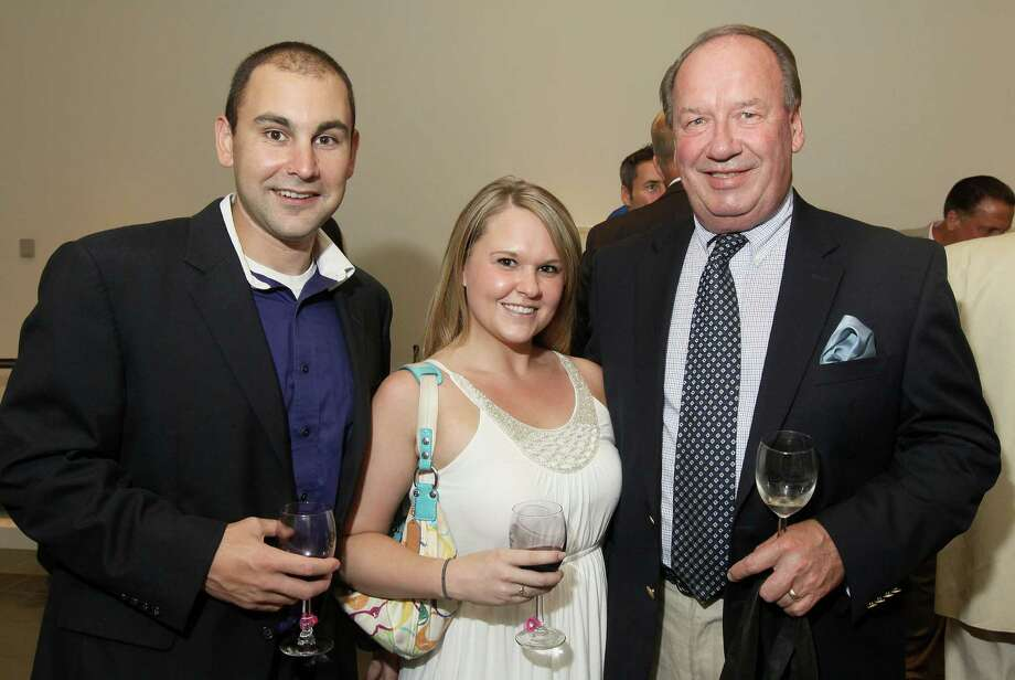 Saratoga Springs, NY - August 24, 2012 - (Photo by Joe Putrock/Special to the Times Union) - (l to r) Albany Devils Sales and Marketing Vice President Chris Valente, his fiancee Rachel Marcotte, and NBT Financial Group Relationship Manager and Wealth Management Advisor Robert Dollar during the 14th Annual Travers Wine Tasting to benefit Senior Services of Albany's 'Meals on Wheels' program and other senior-related services. Photo: Joe Putrock / Joe Putrock
