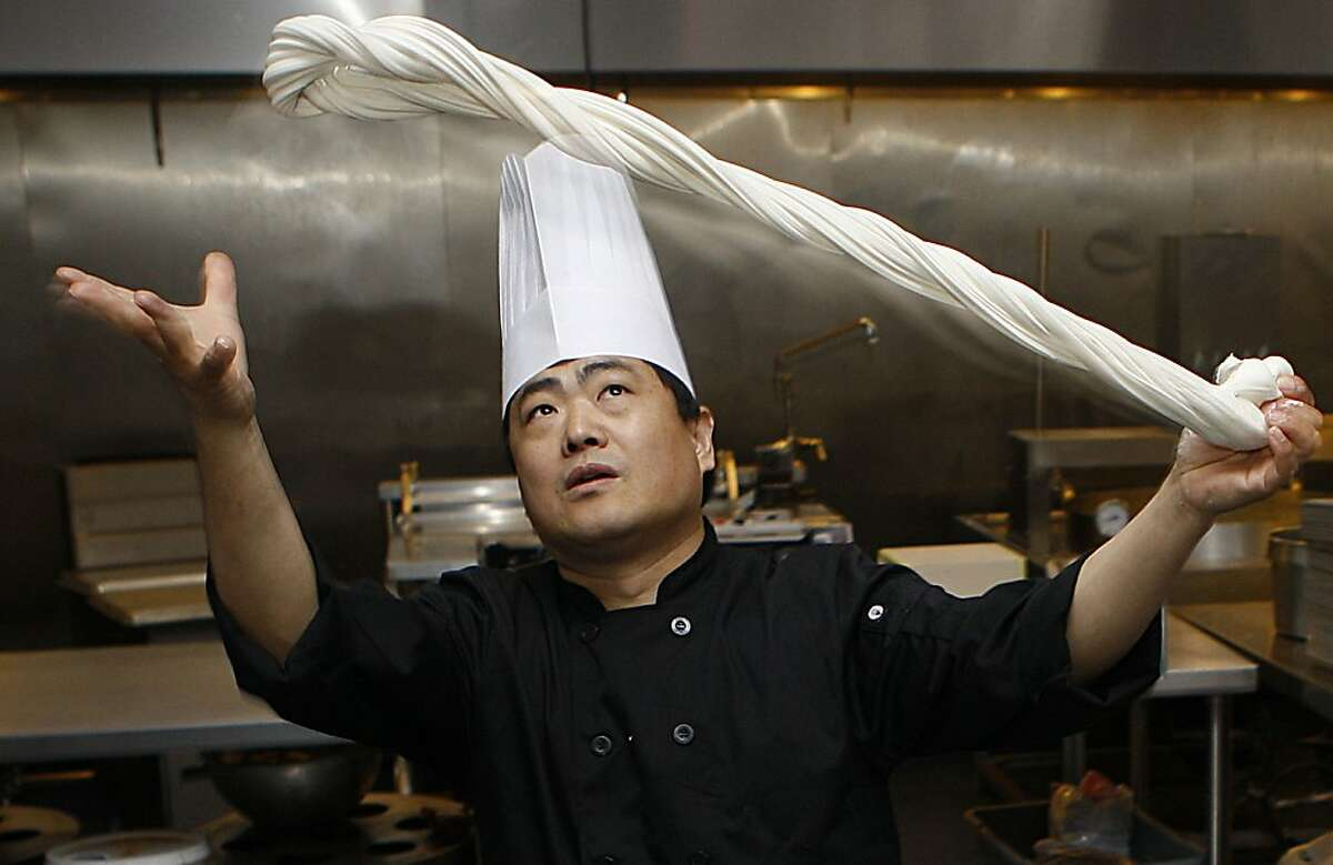 Master chef de cuisine Tony Wu shows how to pull noodles in Millbrae, Calif., on Thursday, August 23, 2012.