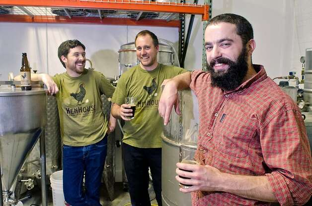 The HenHouse Brewing Company team, Shane Goepel (left), Scott Goyne and Collin McDonnell enjoy a brew of their Oyster Stout in Petaluma, California on August 31, 2012. Photo: Alvin Jornada, Special To The Chronicle