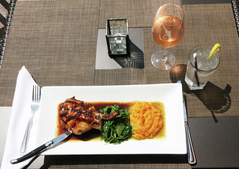 "A plate of ""Dr Pepper"" fire grilled pork chop, sautéed spinach, sweet potato puree, and bourbon demi glaze is a signature dish at the Spotted Horse Tavern in Westport, Conn. Monday, August 13, 2012. Photo: Unknown, B.K. Angeletti / Connecticut Post freelance B.K. Angeletti"