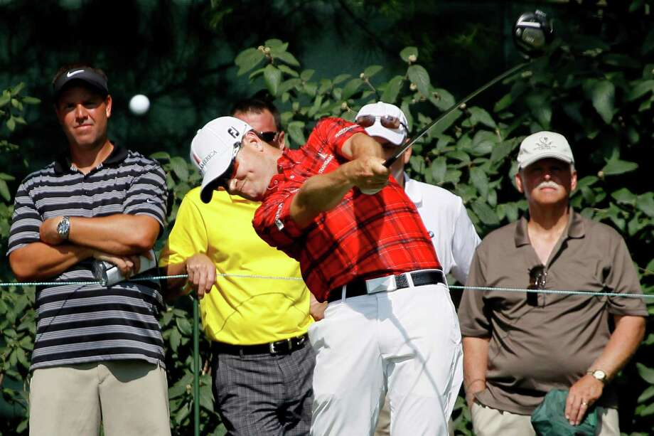 Zach Johnson tees off on the seventh hole during the first round of the BMW Championship PGA golf tournament at Crooked Stick Golf Club in Carmel, Ind., Thursday, Sept. 6, 2012. (AP Photo/Charles Rex Arbogast) Photo: Charles Rex Arbogast, Associated Press / AP