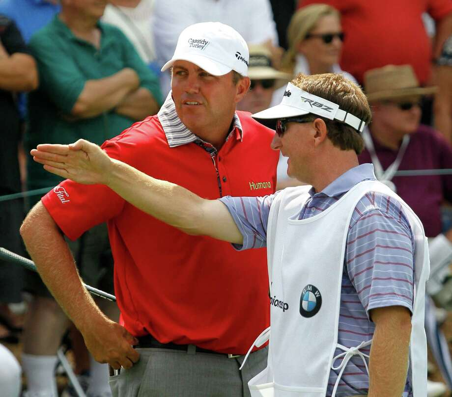 Bo Van Pelt, left, listens to caddie Mark Chaneyto on the 10th hole during the first round of the BMW Championship PGA golf tournament at Crooked Stick Golf Club in Carmel, Ind., Thursday, Sept. 6, 2012. (AP Photo/Charles Rex Arbogast) Photo: Charles Rex Arbogast, Associated Press / AP