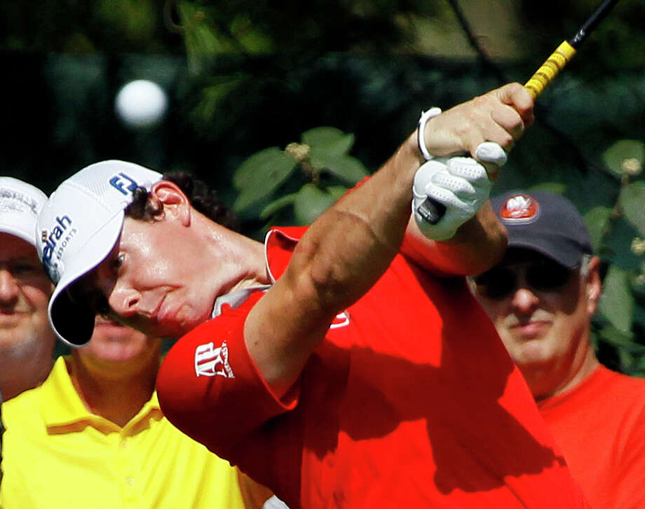 Rory McIlroy, of Northern Ireland, hit his tee shot on the sixth hole during the first round of the BMW Championship PGA golf tournament at Crooked Stick Golf Club in Carmel, Ind., Thursday, Sept. 6, 2012. (AP Photo/Charles Rex Arbogast) Photo: Charles Rex Arbogast, Associated Press / AP