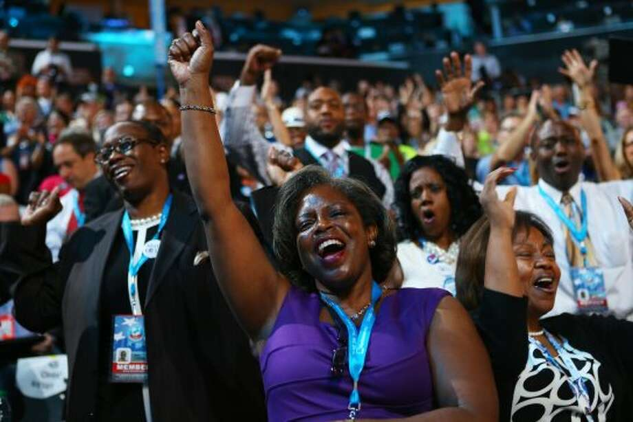 CHARLOTTE, NC - SEPTEMBER 06:  Attendees sing and dance as musician James Taylor performs on stage during the final day of the Democratic National Convention at Time Warner Cable Arena on September 6, 2012 in Charlotte, North Carolina. The DNC, which concludes today, nominated U.S. President Barack Obama as the Democratic presidential candidate.  (Photo by Joe Raedle/Getty Images) (Getty Images)