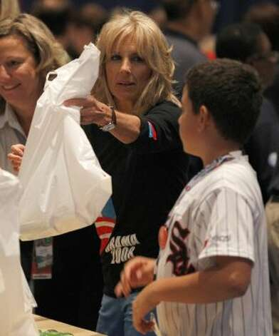Vice President Joe Biden's wife Jill Biden helps fill bags for a USO service project during the Democratic National Convention in Charlotte, N.C., Thursday, Sept. 6, 2012.  (Chuck Burton / Associated Press)