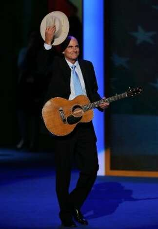 CHARLOTTE, NC - SEPTEMBER 06:  Musician James Taylor walks on stage during the final day of the Democratic National Convention at Time Warner Cable Arena on September 6, 2012 in Charlotte, North Carolina. The DNC, which concludes today, nominated U.S. President Barack Obama as the Democratic presidential candidate.  (Alex Wong / Getty Images)