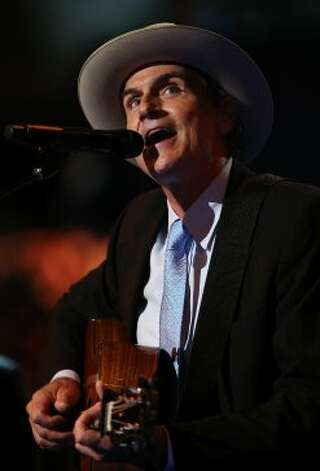 CHARLOTTE, NC - SEPTEMBER 06:  Musician James Taylor performs on stage during the final day of the Democratic National Convention at Time Warner Cable Arena on September 6, 2012 in Charlotte, North Carolina. The DNC, which concludes today, nominated U.S. President Barack Obama as the Democratic presidential candidate.   (Chip Somodevilla / Getty Images)