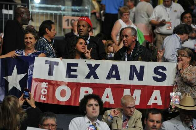 Texas supporters hoist a banner at the Time Warner Cable Arena in Charlotte, North Carolina, on September 6, 2012 on the final day of the Democratic National Convention (DNC). US President Barack Obama is expected to accept the nomination from the DNC to run for a second term as president.  (MLADEN ANTONOV / AFP/Getty Images)