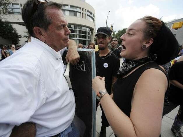Rev. Benham, left, of North Carolina, and an Occupy demonstrator have a heated verbal exchange about women's reproductive rights outside the convention center, Thursday, Sept. 6, 2012, in Charlotte, N.C., during the last day of the Democratic National Convention. (Mike Stewart / Associated Press)