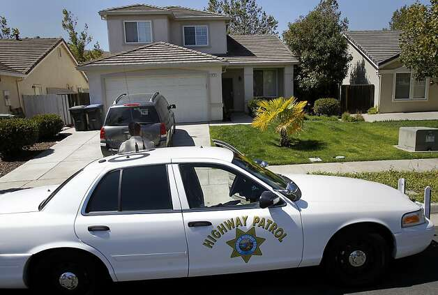 CHP officers kept watch over the Youngstrom home in Cordelia, Calif. Law enforcement officers and neighbors and friends recalled California Highway Patrol officer Kenyon Youngstrom who passed away after being shot on highway 680 earlier this week. Photo: Brant Ward, The Chronicle