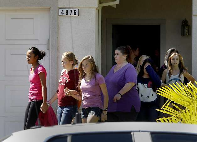 Friends of the children of Kenyon Youngstrom left the family home after bringing food Thursday September 6, 1012. Law enforcement officers and neighbors and friends recalled California Highway Patrol officer Kenyon Youngstrom who passed away after being shot on highway 680 earlier this week. Photo: Brant Ward, The Chronicle