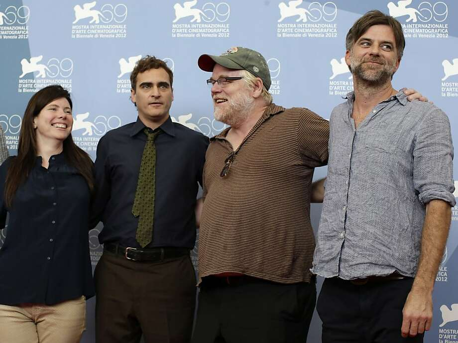 "Producer JoAnne Sellar (left), actors Joaquin Phoenix and Philip Seymour Hoffman and director Paul Thomas Anderson promote ""The Master"" in Venice. Photo: Andrew Medichini, Associated Press"