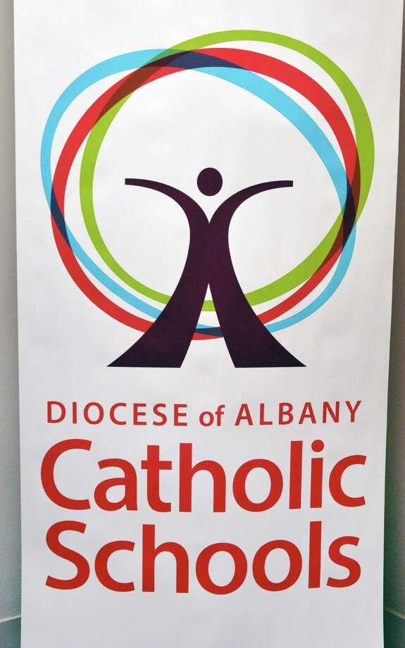A poster bearing the new logo for the unifying campaign to promote the diocese's 23 schools at the Albany Catholic Diocese Headquarters in Albany Tuesday Sept. 4, 2012.  (John Carl D'Annibale / Times Union) Photo: John Carl D'Annibale / 00019096A