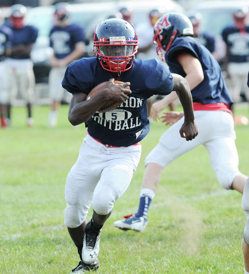 Brien McMahon running back Trevon Forney #5 in srimmage against Bridgeport Central High School during the high School football jamboree at Wilton High School, Saturday morning, Sept. 1, 2012. Photo: Bob Luckey / Greenwich Time