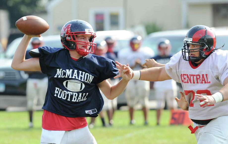Kevin Contreas # 72 of Bridgeport Central High School, right, pressures Brien McMahon quarterback Trey Newcomb during the high School football jamboree at Wilton High School, Saturday morning, Sept. 1, 2012. Photo: Bob Luckey / Greenwich Time
