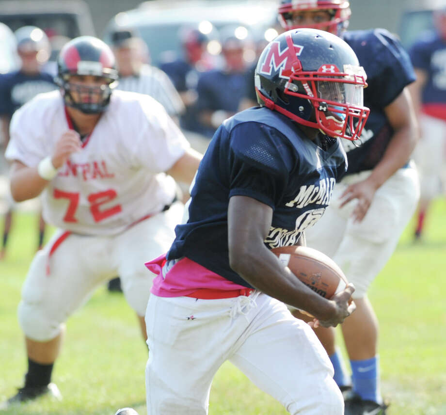 Brien McMahon running back Trevon Forney #5 in srimmage against Bridgeport Central High School during the high School football jamboree at Wilton High School, Saturday morning, Sept. 1, 2012. At left for Central is Kevin Contreas # 72. Photo: Bob Luckey / Greenwich Time