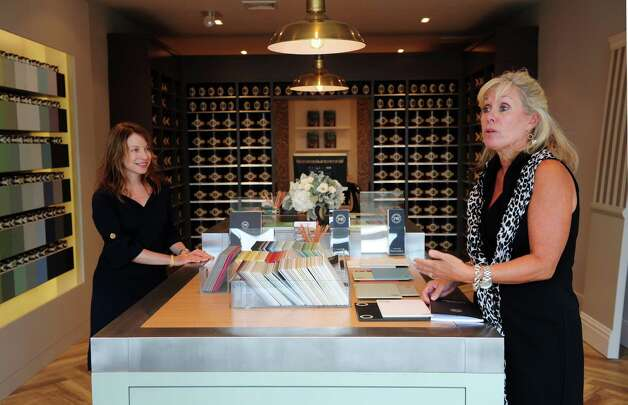 Christine Klotz, Tri-State lead showroom manager, left, and Kathy Banfe, President of North American Sales and Marketing, stand in the new Farrow & Ball showroom in Westport, Conn. Wednesday, Sept. 5, 2012. Photo: Autumn Driscoll / Connecticut Post