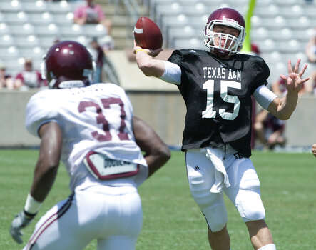 Texas A&M's freshman quarterback Johnny Manziel prepares to pass during the annual Maroon and White Game at Kyle Field in College Station Saturday, April 16, 2011. Click ahead to see more photos of Johnny Football at Texas A&M.  Photo: Stuart Villanueva, AP / Bryan College Station Eagle