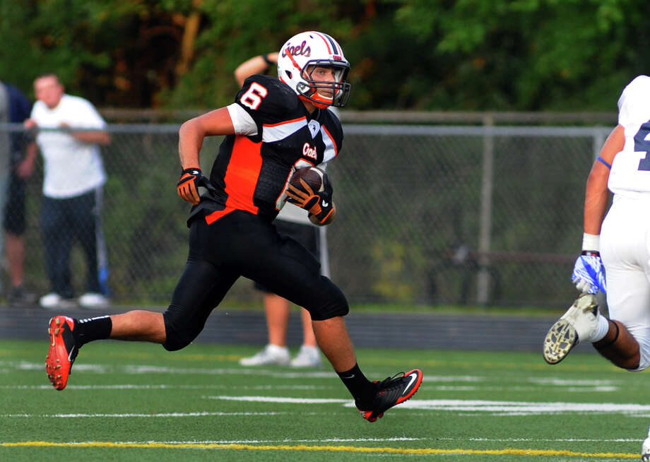 Shelton's William Karcher carries the ball, during football scrimmage action against Ansonia in Shelton, Conn. on Thursday September 6, 2012. Photo: Christian Abraham / Connecticut Post