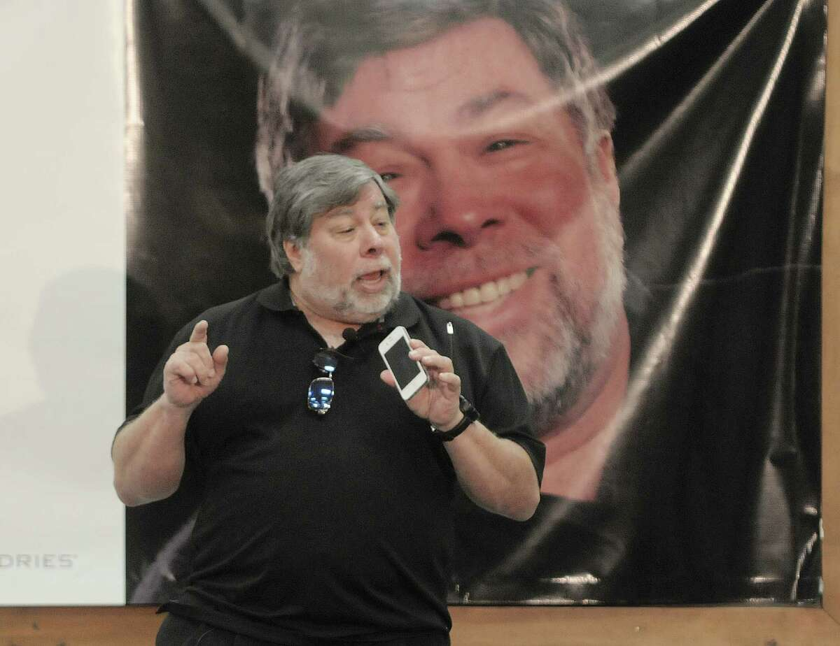 Steve Wozniak, co-founder of Apple computers, holds up his iPhone as he gives a talk to students, faculty, staff and guests at Tech Valley High School on Thursday, Sept. 6, 2012 in Rensselaer, NY. Wozniak said that he believes one day the smart phone will have the ability to sense smells, saying that the phone already incorporates other human like senses. Wozniak took a student led tour of the school before giving a talk and answering questions from the students. Wozniak was the featured speaker on the first day of classes for students. (Paul Buckowski / Times Union)