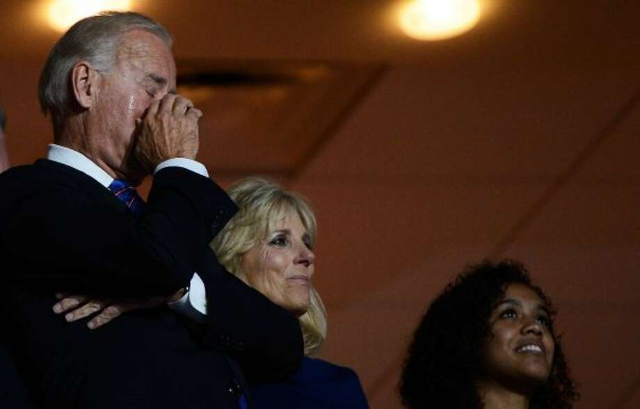 CHARLOTTE, NC - SEPTEMBER 06:  Democratic vice presidential candidate, U.S. Vice President Joe Biden, wiping his eye, and his wife Second lady Dr. Jill Biden (C) watch as their son Attorney General of Delaware Beau Biden speaks during the final day of the Democratic National Convention at Time Warner Cable Arena on September 6, 2012 in Charlotte, North Carolina. The DNC, which concludes today, nominated U.S. President Barack Obama as the Democratic presidential candidate.   (Kevork Djansezian / Getty Images)