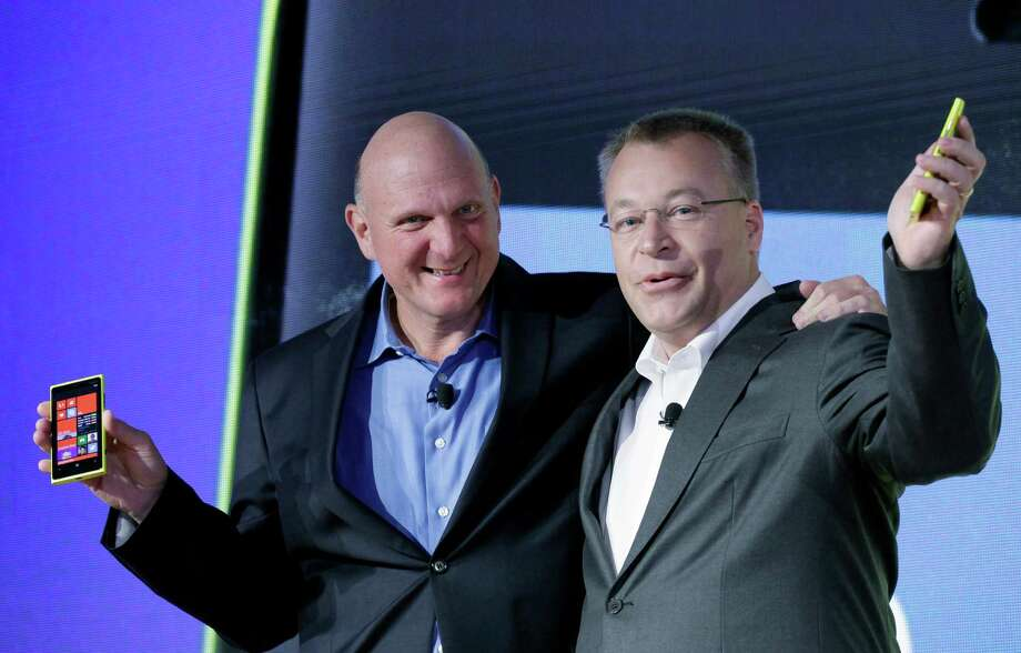 Steve Ballmer, left, Chairman and CEO of Microsoft, and Stephen Elop, President and CEO of Nokia, introduce Nokia's newest smartphone, the Lumia 920, equipped with Microsoft's Windows Phone 8, Wednesday, Sept. 5, 2012 in New York.  Nokia revealed its first smartphones to run the next version of Windows, a big step for a company that has bet its future on an alliance with Microsoft. (AP Photo/Mark Lennihan) Photo: Mark Lennihan