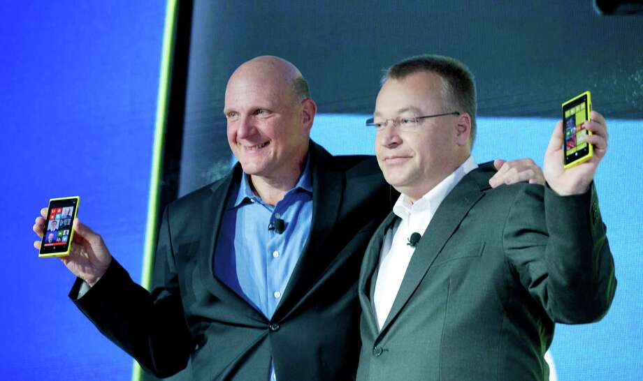 But Microsoft soon announced Windows Phone 8, stanching enthusiasm for the Lumia 900. Here, Microsoft CEO Steve Ballmer, left, and Nokia CEO Stephen Elop introduce the Lumia 920, equipped with Windows Phone 8, on Sept. 5, 2012 in New York. Photo: Mark Lennihan