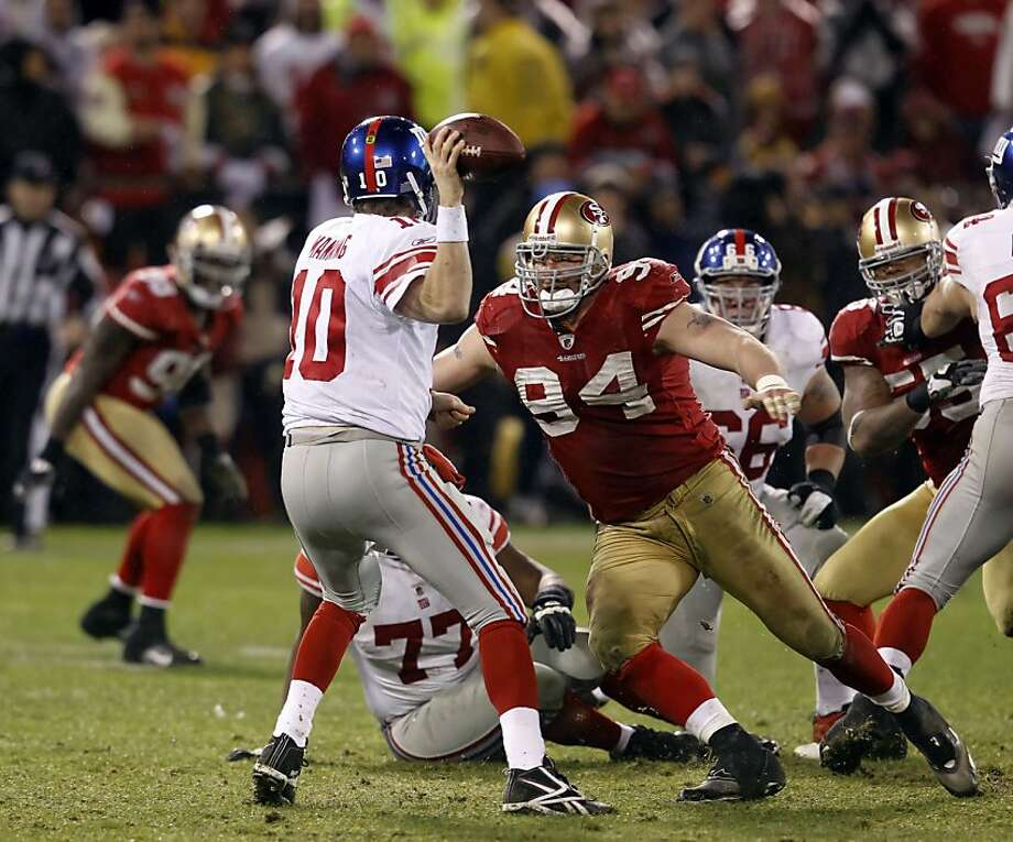 "Justin Smith, bearing down on Eli Manning in last year's NFC Championship, warns of ""windows of opportunity"" closing. Photo: Brant Ward, The Chronicle"