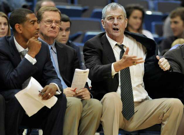 Connecticut head coach Jim Calhoun, right, gestures as assistant head coach Kevin Ollie, left, and associate head coach George Blaney, center, look on in the second half of an NCAA college basketball game against Coppin State in Hartford, Conn., on Sunday, Nov. 20, 2011. (AP Photo/Jessica Hill) Photo: Jessica Hill, Associated Press / AP2011