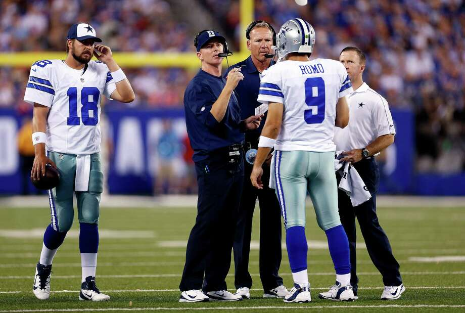 Coach Jason Garrett (center left) said Tony Romo and the Cowboys have much room to improve despite doing some things well in a 24-17 season-opening win against the Giants. Photo: Julio Cortez, Associated Press / AP