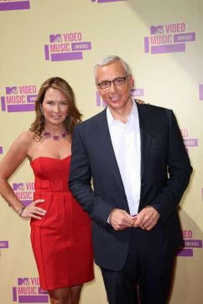 Television personality Dr. Drew Pinsky (right) and his wife Susan Pinsky arrive. (Frederick M. Brown