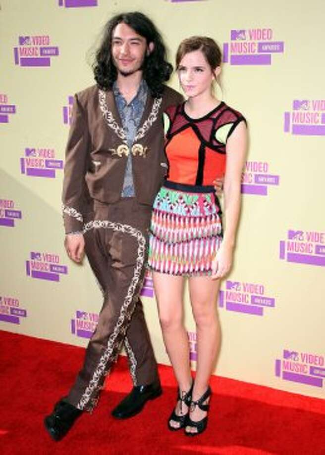Ezra Miller's and Emma Watson's wardrobes; can't event talk about it. (Frederick M. Brown / Getty Images)