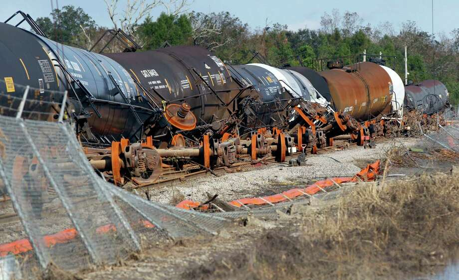 Rail cars are knocked off their wheels after floodwaters from Hurricane Isaac receded in Braithwaite, La., Thursday, Sept. 6, 2012.  Isaac hit southeast Louisiana and coastal Mississippi last week, causing severe flooding and seven deaths. Photo: Gerald Herbert, Associated Press / AP