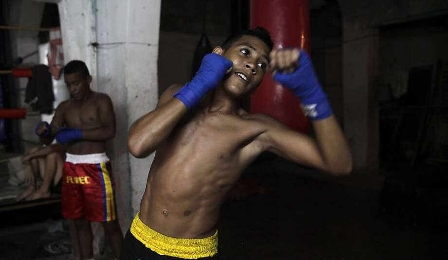 Nike Theran practices at the Promises From My Neighborhood boxing school in the San Roque neighborhood in Barranquilla, Colombia, Thursday, Sept. 6, 2012. Amateur boxer Alex Theran, who was born in Barranquilla, sponsors the gym where boys wanting to become boxers are trained free of charge. Nike is coach Theran's son. Photo: Fernando Vergara, Associated Press
