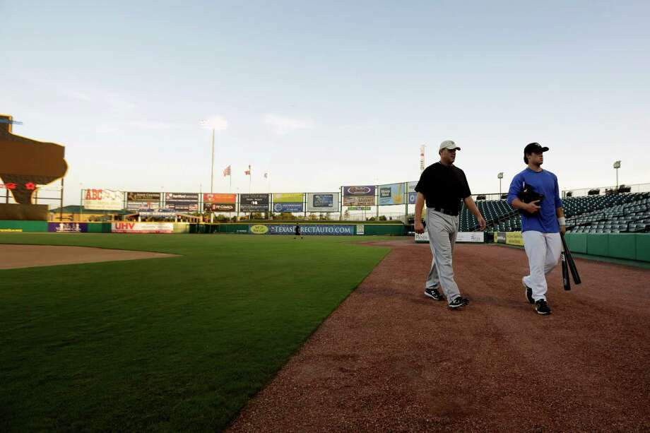 Roger Clemens and his son Koby walk into the stadium prior to a workout, Thursday, September 6, 2012 at Constellation Field in Sugar Land, Texas. Photo: TODD SPOTH, For The Chronicle / Todd Spoth