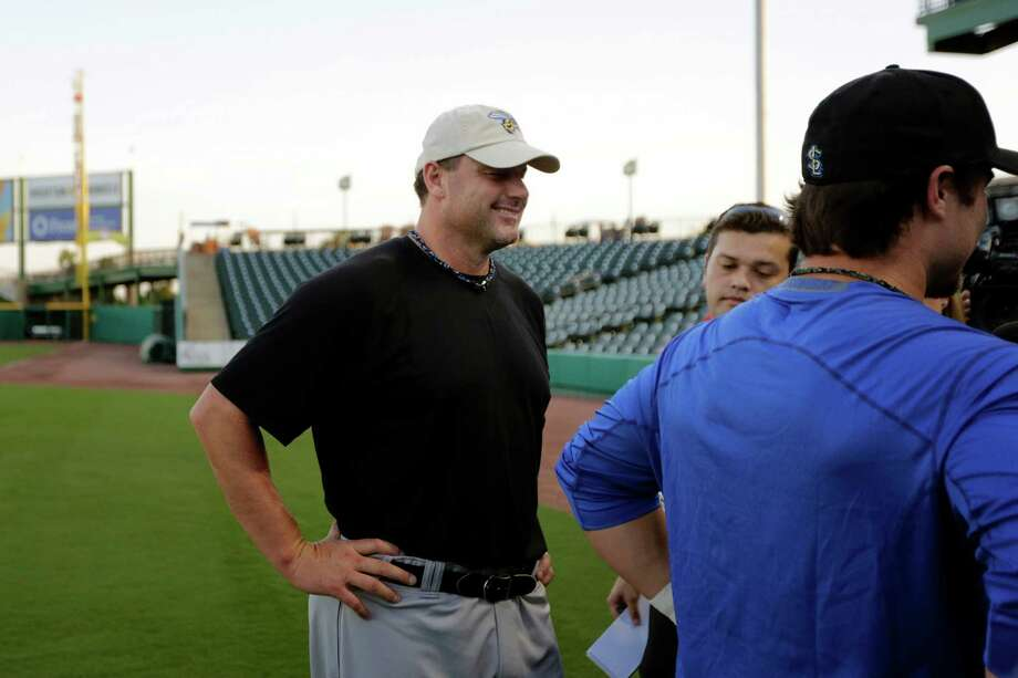 Roger Clemens laughs as he watches his son, Koby, talk to members of the media during a workout, Thursday, September 6, 2012 at Constellation Field in Sugar Land, Texas. Photo: TODD SPOTH, For The Chronicle / Todd Spoth