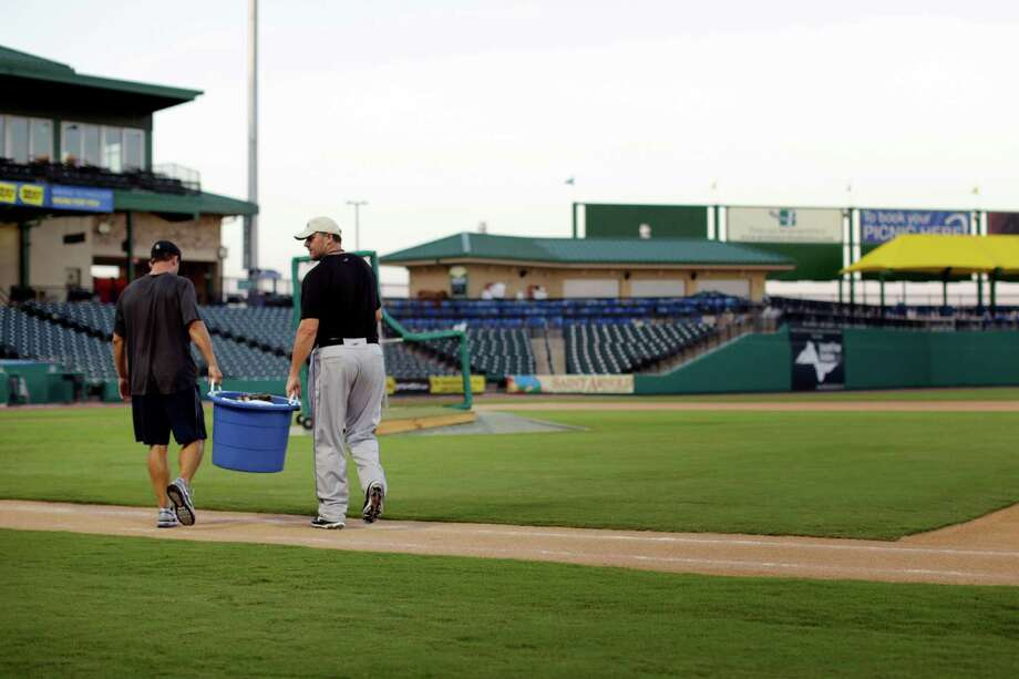 Roger Clemens walks a bucket of baseballs out to the mound during a workout, Thursday, September 6, 2012 at Constellation Field in Sugar Land, Texas. Photo: TODD SPOTH, For The Chronicle / Todd Spoth