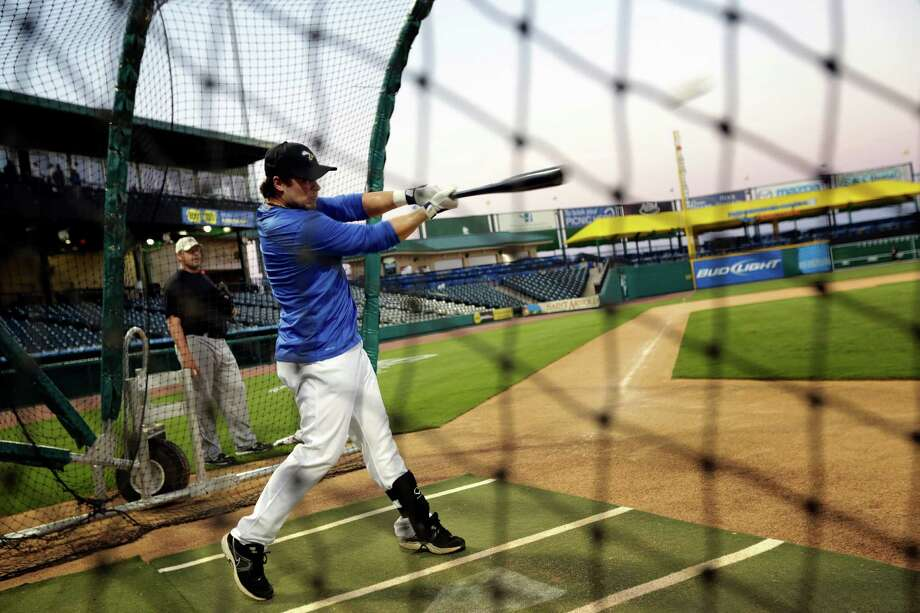 Roger Clemens, rear, watches his son, Koby, take batting practice during a workout, Thursday, September 6, 2012 at Constellation Field in Sugar Land, Texas. Photo: TODD SPOTH, For The Chronicle / Todd Spoth