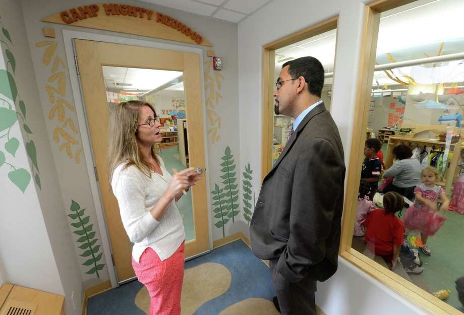 New York State Department of Education Commissioner John King Jr. speaks to Victory riedy, Owner/Operator of the Club Fed DayCare during a tour of the center in the Leo O'Brien Building in Albany, N.Y. Sept 6, 2012.  (Skip Dickstein/Times Union) Photo: Skip Dickstein / 00019158A