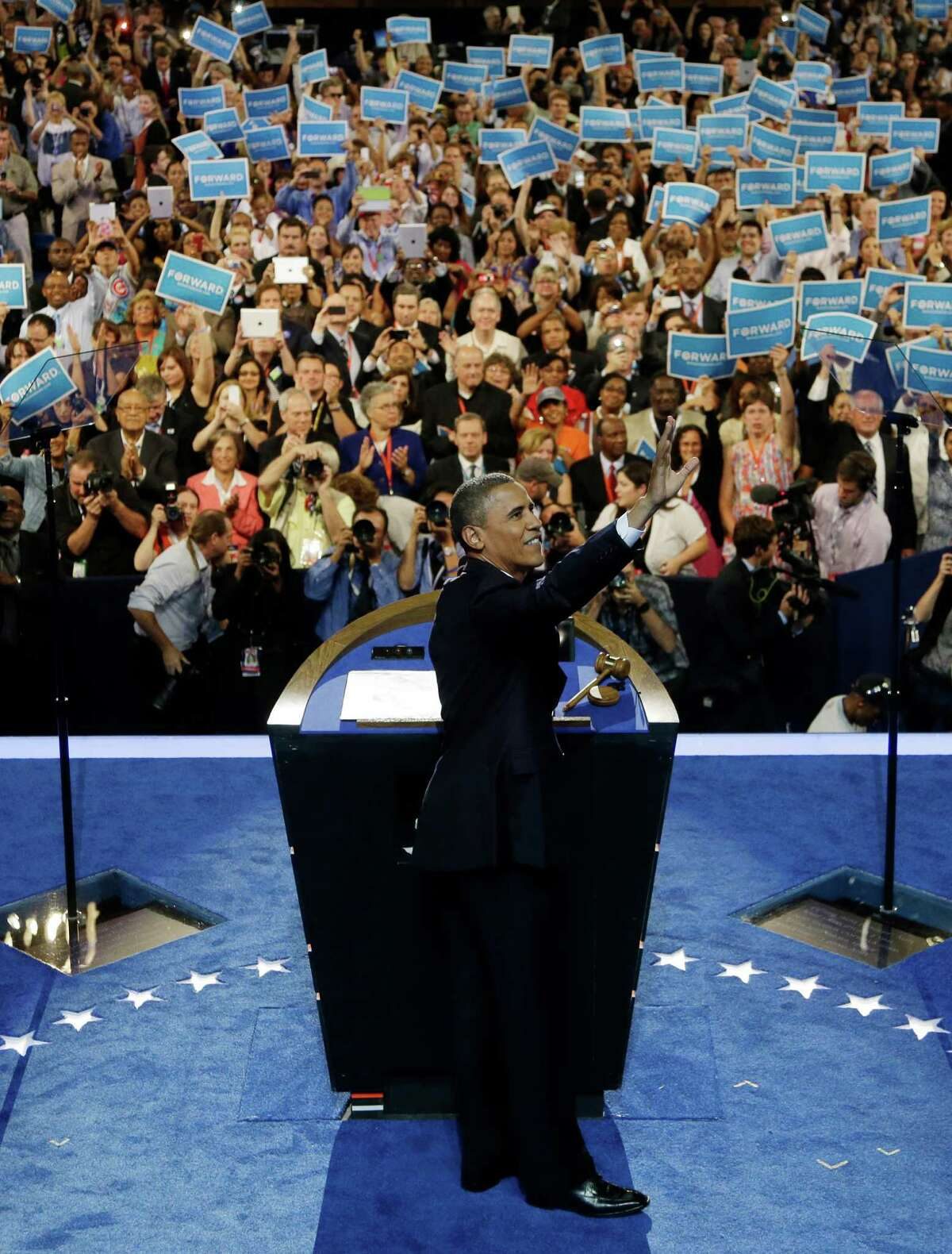 President Barack Obama waves to delegates at the Democratic National Convention in Charlotte, N.C., on Thursday, Sept. 6, 2012. (AP Photo/Charlie Neibergall)