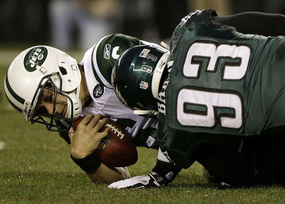 Philadelphia Eagles defensive end Jason Babin (93) sacks New York Jets quarterback Mark Sanchez in the first half of an NFL football game on Sunday, Dec. 18, 2011, in Philadelphia. (AP Photo/Matt Slocum) Photo: Matt Slocum, Associated Press