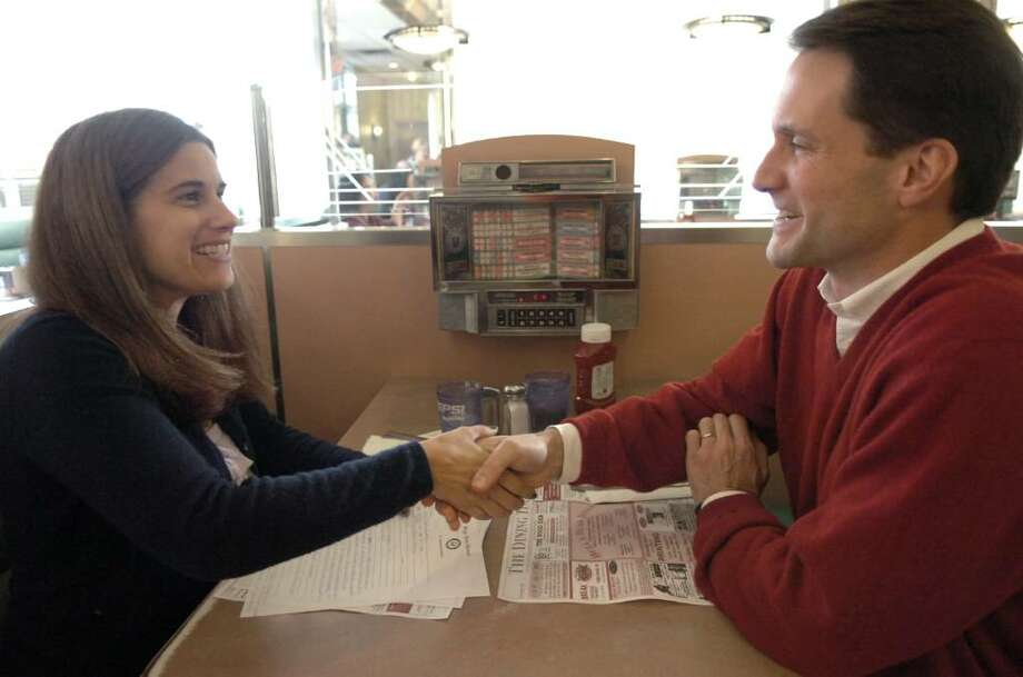 Congressman Jim Himes, left, stops into Bulls Head Diner in Stamford to meet with constituents including Mary Welsch-Lehmann, Nov. 21, 2009. Photo: Keelin Daly / Greenwich Time