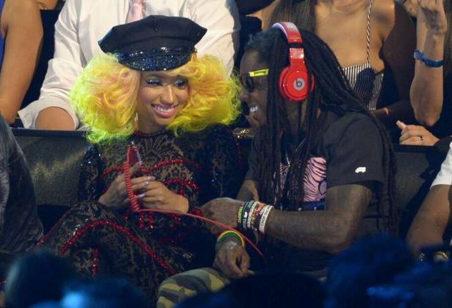 Nicki Minaj, left, and Lil Wayne sit in the audience in the audience at the MTV Video Music Awards on Thursday, Sept. 6, 2012, in Los Angeles.  (Mark J. Terrill / Associated Press)