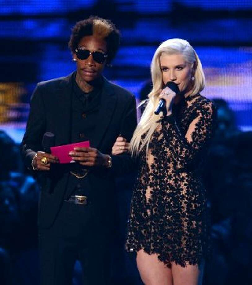 Expectant dad Wiz Khalifa and singer Ke$ha speak onstage during the 2012 MTV Video Music Awards at Staples Center on September 6, 2012 in Los Angeles, California.   (Kevin Winter / Getty Images)