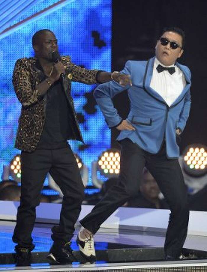 Host Kevin Hart, left, and South Korean rapper PSY perform onstage at the MTV Video Music Awards on Thursday, Sept. 6, 2012, in Los Angeles.  (Mark J. Terrill / Associated Press)