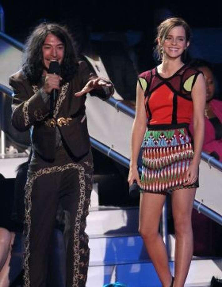 Ezra Miller, left, and Emma Watson speak onstage at the MTV Video Music Awards on Thursday, Sept. 6, 2012, in Los Angeles.  (Matt Sayles / Associated Press)