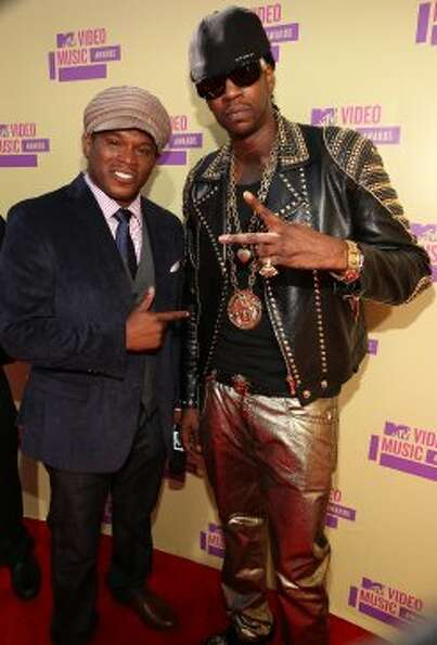 Sway (left) and rapper 2 Chainz arrive. (Christopher Polk / Getty Images)