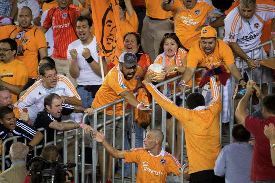 Houston Dynamo midfielder Colin Clark celebrates with fans after scoring on a penalty kick during stoppage time for a 1-0 victory over Real Salt Lake in an MLS soccer match on Thursday, Sept. 6, 2012, at BBVA Compass Stadium in Houston. Photo: Smiley N. Pool, Houston Chronicle / © 2012  Houston Chronicle