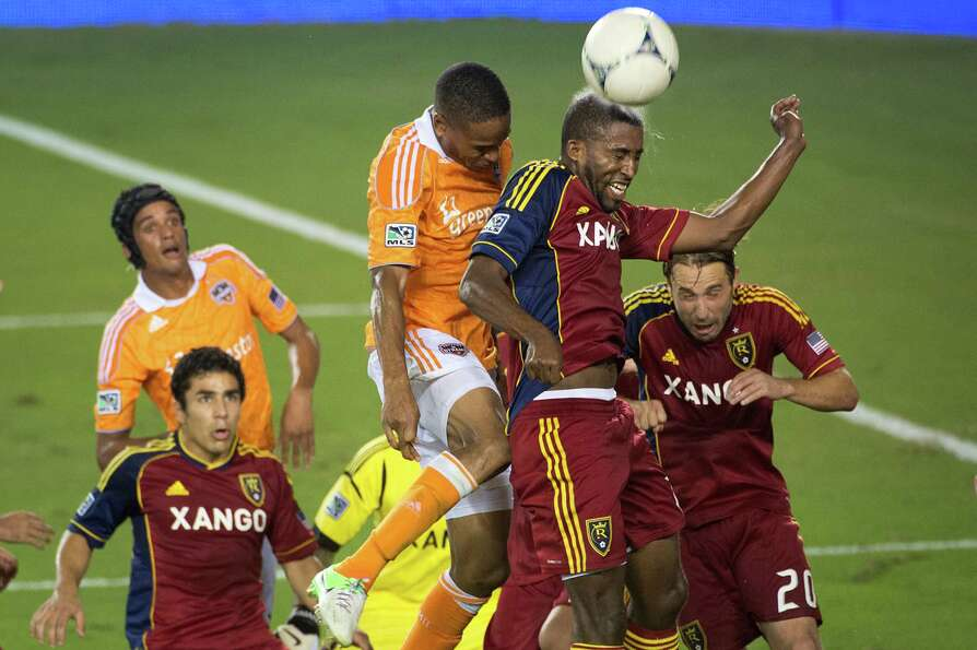 Real Salt Lake midfielder Yordany Alvarez wins a header against Houston Dynamo defender Ricardo Clar